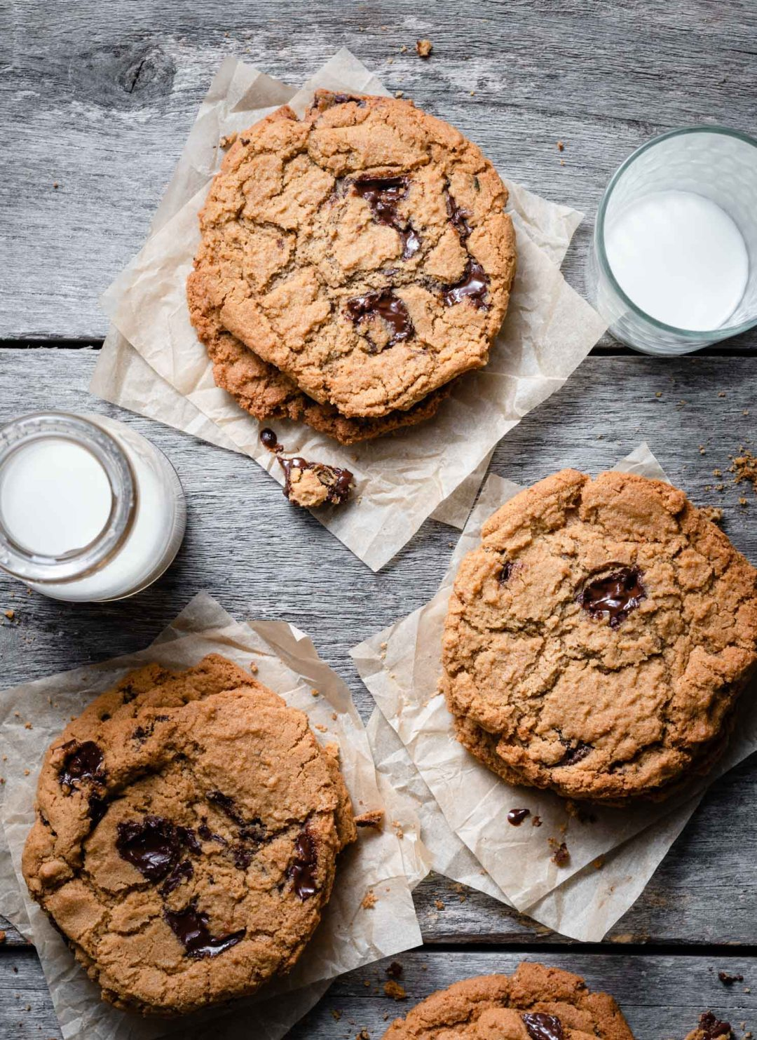 Chocolate Chunk Cookies stacked with a glass of milk.