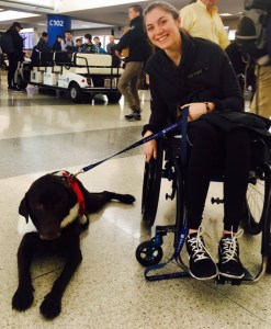 Alison Avery at airport with service dog