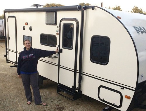 Laura standing next to the new camper