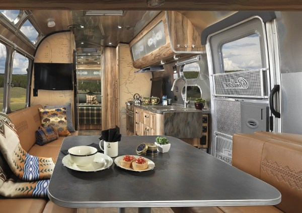 Two timeless American brands, Airstream and Pendleton Woolen Mills, have come together for the first time to pay tribute to our nation's parks and to great outdoor adventure. Coinciding with the centennial of the National Park Service, Airstream proudly introduces the 2016 Limited Edition Pendleton National Park Foundation travel trailer. (PRNewsFoto/Airstream)