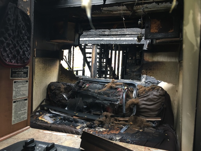 Fire-damaged camper couch