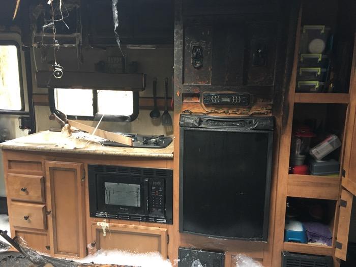 Fire-damaged camper kitchen