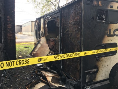 Backside of fire-damaged camper