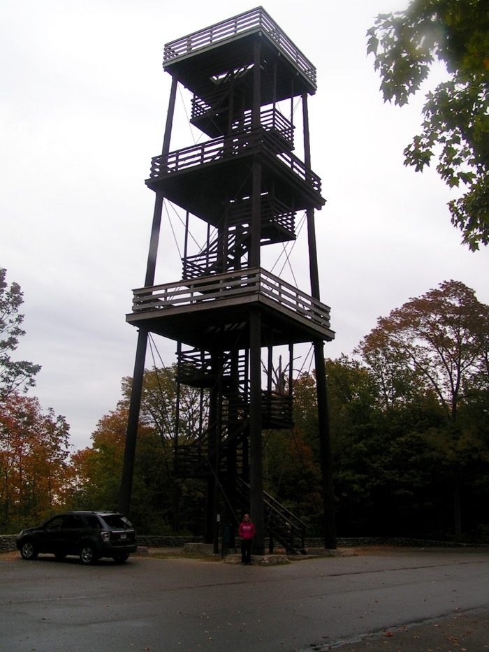 Laura stands at the base of Eagle Tower in Peninsula State Park