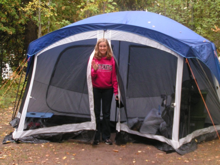 Laura exiting tent while camping at Peninsula State Park