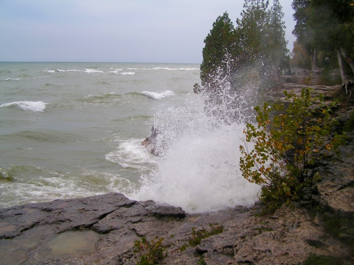 Waves crashing against rocks at Cave Point County Park