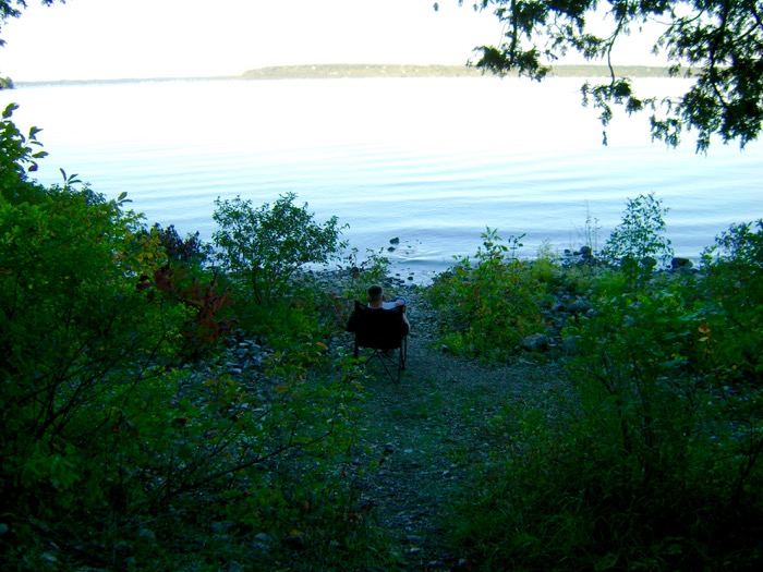 Jason sits at water's edge at our campsite in Peninsula State Park in Door County