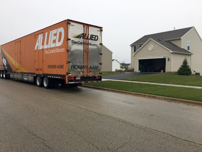 Moving truck in front of the house