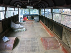 The bus with it's floorboards exposed, should make installing the floating floorboards easier.