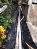 Back downspout and trench