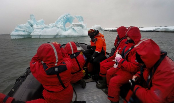 Checking out one of the many crazy cool icebergs during a Zodiac cruise.