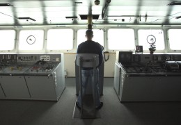 Manning the helm on the bridge of the Ioffe.