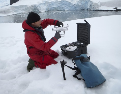 Dusty preps the drone for takeoff in Antarctica.