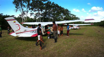 Local Huaorani villagers descend on the airstrip in the village of Quehuere Ono to greet our planes when we arrived.