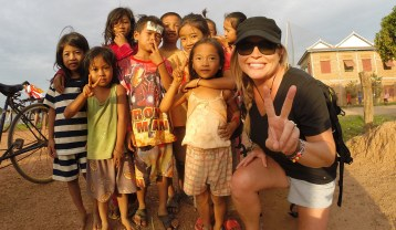 Meeting new friends! Along the Mekong River in Cambodia.