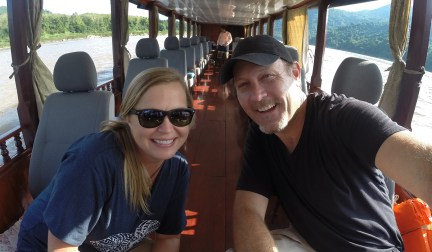 Cruising the Mekong by long boat in Laos.
