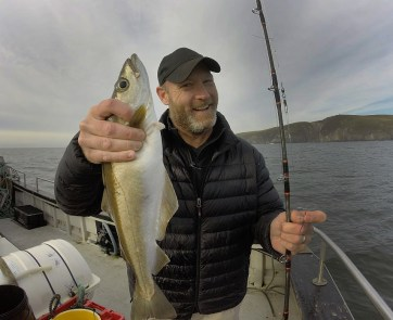 ...and sure enough! We got into 'em! Check out this fine white pollock! A thrill to catch!