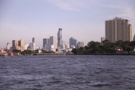 Cruising along the Chao Praya River. Looks peaceful. But we know better.