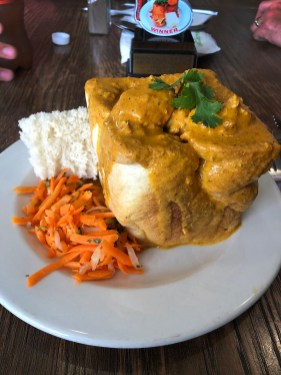 """Pull up a chair and feast on Durban's signature dish, the Indian-inspired """"Bunny Chow!"""" And it is every bit as hearty and delicious as it looks. Yum!"""