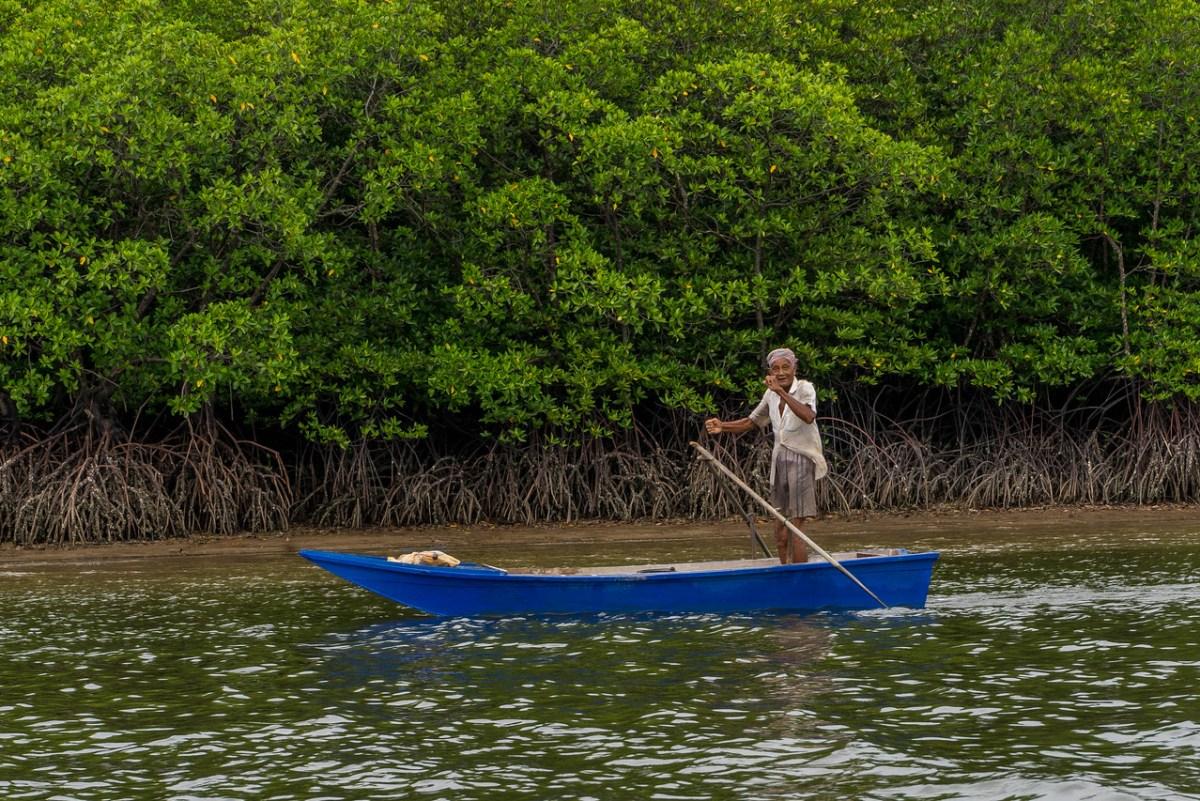 old man in canoe thailand
