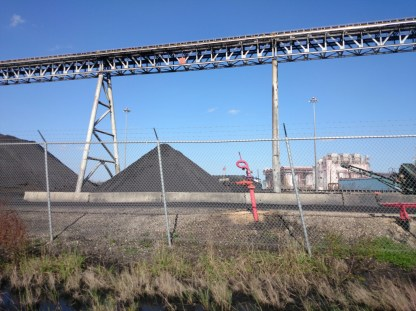 Enormous piles of coal and large conveyor belts.