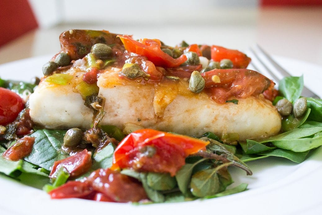 Roasted Halibut with Tomatoes and Capers. Silky fish topped with delicious flavours.