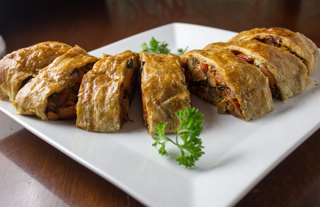 Simple Savoury Vegetable Strudel with sweet potato, onion, peppers, spinach and goat cheese filling in a puff pastry wrap.
