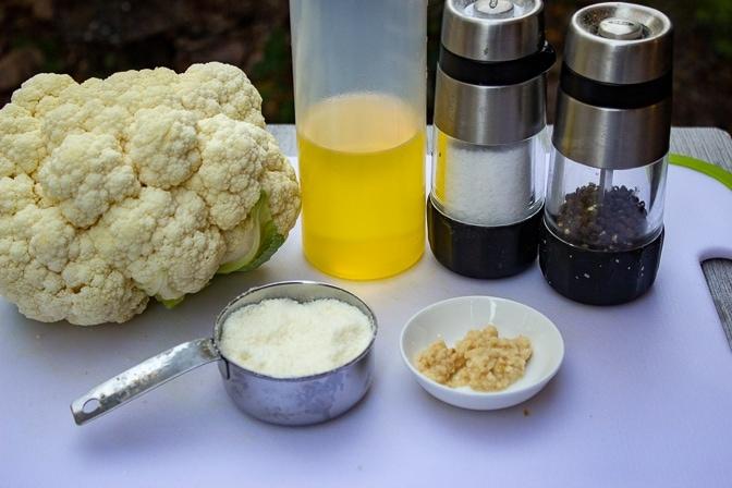 cauliflower head, olive oil, parmesan, salt, garlic, pepper
