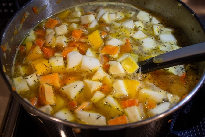 diced root vegetables with broth and seasonings in pot