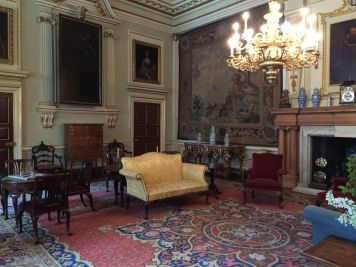 The lower hall/drawing room. The portrait of the Black Prince on the left is the one on hinges.