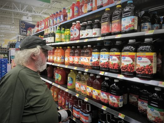 Photo of Robert Selecting Cranberry Juice