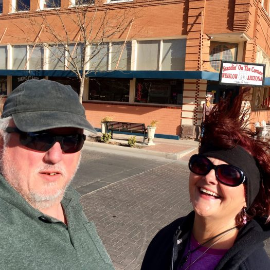 Photo of Debra and Robert Standing On A Corner in Winslow Arizona
