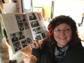 Debra points out a photo of Robert in an old school yearbook from the 1980s