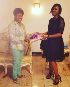 Ms, Creative Director/ Designer Twon-by-Jane present a sample of the Suzzette collection to the First Lady of Rivers State