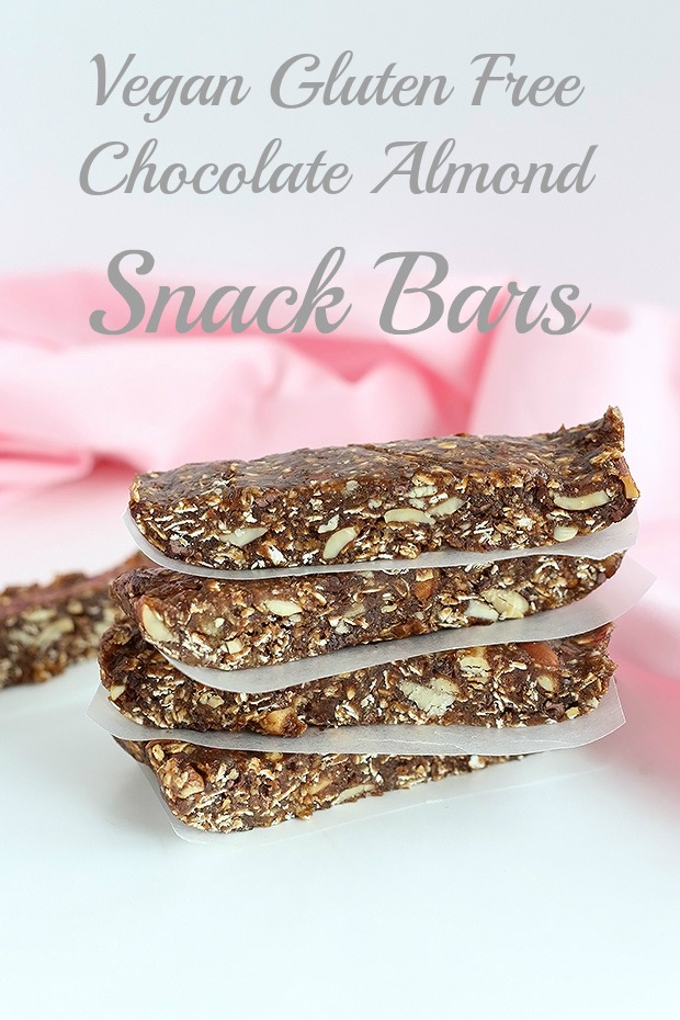 These Vegan Gluten Free Chocolate Almond Snack Bars are super easy to make. They only require 9 simple, whole ingredients including oats and almond butter! / TwoRaspberries.com