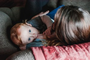 breastfeeding mother and her red-head, blue-eyed son