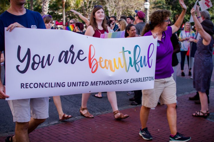 Members of Two Rivers march along side other United Methodists from the area during the 2018 Charleston Pride parade.
