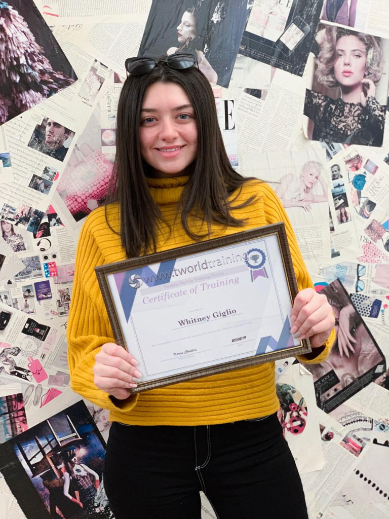 Fashion Stylist Student receiving her certificate of excellence, for completing her fashion styling course.