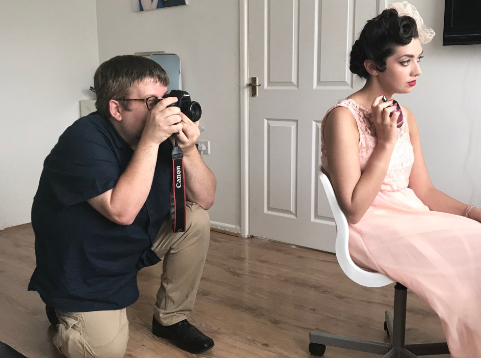 Behind the scenes shot of student on a vintage wedding photography course