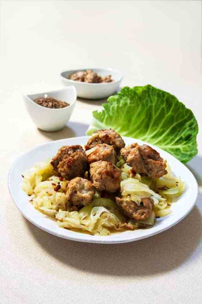 Homemade Instant Pot Low Carb Chicken Bratwurst and Cabbage dinner. This easy chicken sausage recipe makes meatballs that are very mildly spiced but flavorful, and sure to be very kid-friendly.