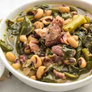Dump and cook Southern style beans and greens cook up fast and creamy in your pressure cooker. Fast way to make dish that used to take all day on the stove. Omit ham hocks for vegan version.