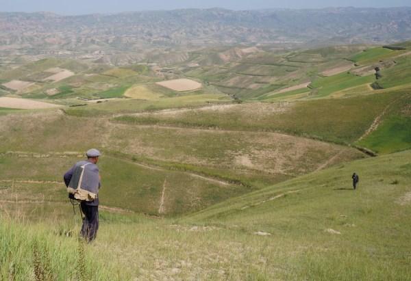Herdsman over the valley of Xin Zhan, Yongdeng, Gansu
