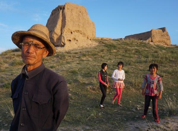 Locals beneath the village fort, Jianshan Village, Jingtai