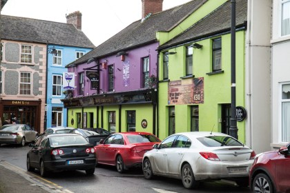 Colourful buildings and many pubs and restaurants. This one looks like it is calling us...