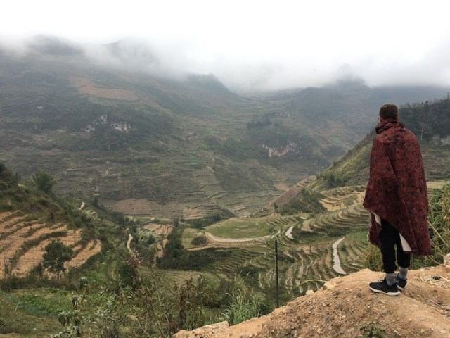 Matt taking in the green landscape and rice terraces on the Ha Giang Loop