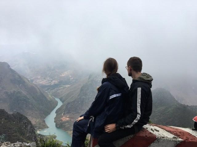 Matt and Lorna sitting overlooking views during the Ha Giang Loop