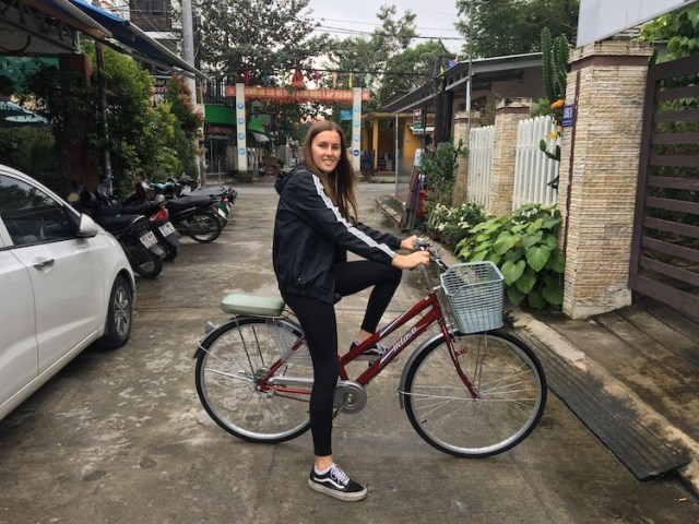 Lorna on bicycle in Hoi-An-Vietnam-backpacking-route-Two-Souls-One-Path