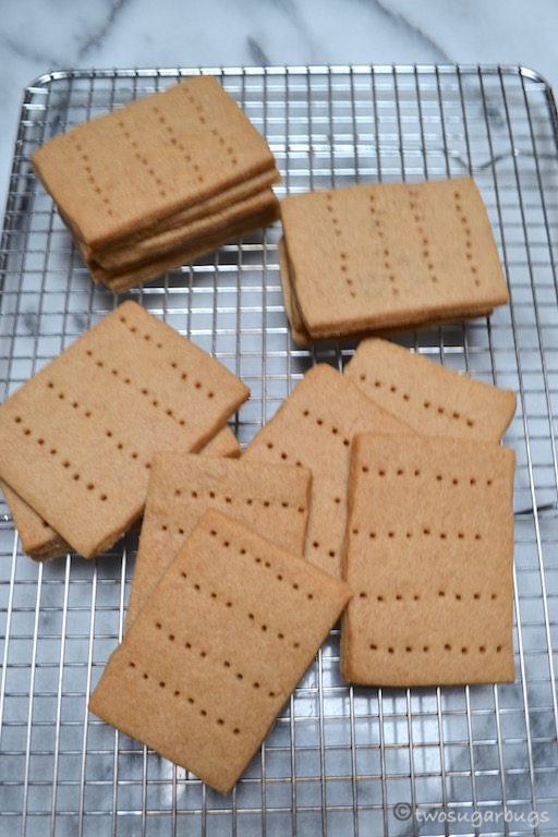 Homemade graham crackers are perfect for homemade s'mores or animal crackers. You may never go back to store bought!#twosugarbugs #homemadegrahamcrackers #grahamcrackers #smores