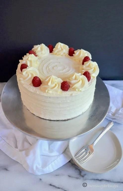 Homemade Raspberry Cake with White Chocolate Swiss Meringue Buttercream #twosugarbugs #cake #raspberries