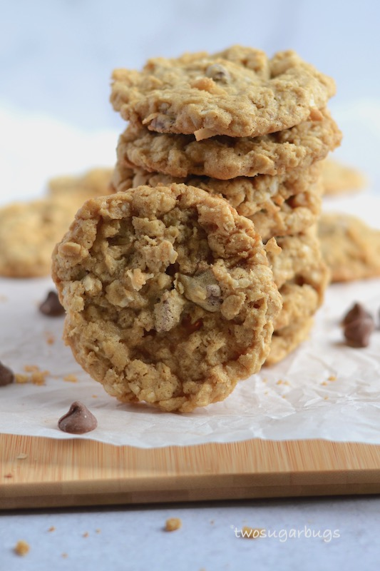 Soft and chewy oatmeal, coconut, chocolate chip cookies. #twosugarbugs #oatmealcookies #oatmealchocolatechip